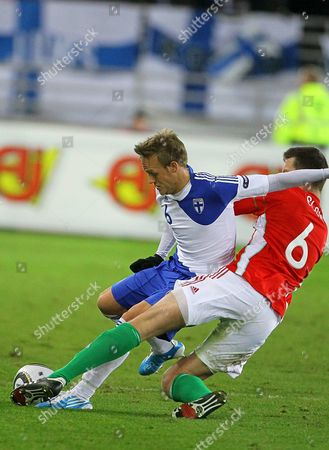 Finland's Jonatan Johansson (l) Vies For the Ball with Hungary's Akos Elek (r) During the Uefa Euro 2012 Qualifying Soccer Match Between Finland and Hungary at the Olympic Stadium in Helsinki Finland 12 October 2010 Hungary Won 2-1 Finland Helsinki