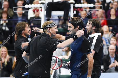 Stock Image of Jarkko Nieminen (2-l) and Icehockey Palyer Teemu Selanne (l) of Finland Vs Icehockey Player Peter Forsberg (r) of Sweden and Roger Federer (2-r) of Swizerland During the Jarkko Nieminen Vs Roger Federer Final Night Event at the Hartwall Arena in Helsinki Finland 09 November 2015 Finnish All Time Tennis Ace Jarkko Nieminen Faces Roger Federer in His Career Ending Match Finland Helsinki