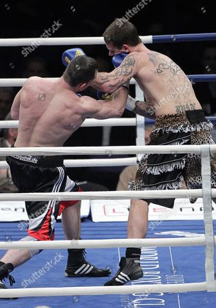 Stock Image of Sam Couzens (r) From United Kingdom Boxes with Artur Hein (l) From Germany During Their Light Heavyweight-8 Rounds Fight at the Hartwall Areena in Helsinki Finland on 27 November 2010 Finland Helsinki