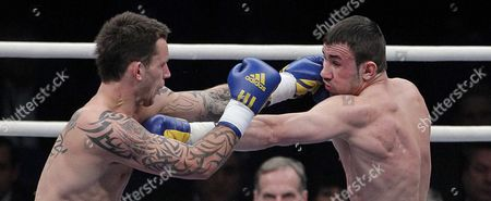 Stock Photo of Sam Couzens (l) From United Kingdom Boxes with Artur Hein (r) From Germany During Their Light Heavyweight-8 Rounds Fight at the Hartwall Areena in Helsinki Finland on 27 November 2010 Finland Helsinki