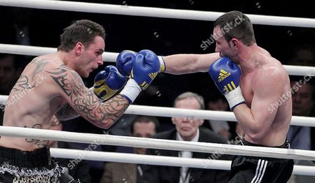 Stock Picture of Sam Couzens (l) From United Kingdom Boxes with Artur Hein (r) From Germany During Their Light Heavyweight-8 Rounds Fight at the Hartwall Areena in Helsinki Finland on 27 November 2010 Finland Helsinki