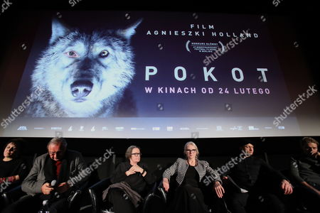 "Writer, co-writer Olga Tokarczuk (L), producer and director Krzysztof Zanussi (2,L) film director Agnieszka Holland (C) and actors Agnieszka Mandat (3,R) and Borys Szyc (2,R) after the press screening of the film ""Pokot"", in Warsaw cinema Atlanctic, 06 February 2017. The film is based on the novel by Olga Tokarczuk ""Drive your plow over the bones of the dead."""