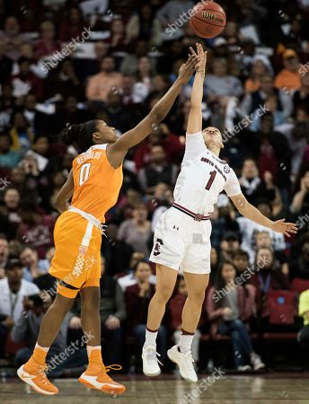 Bianca Cuevas-Moore, Jordan Reynolds South Carolina guard Bianca Cuevas-Moore (1) and Tennessee guard Jordan Reynolds (0) reach for loose ball during the second half of an NCAA college basketball game, in Columbia, S.C. Tennessee defeated South Carolina 76-74