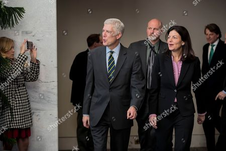 Neil Gorsuch, Kelly Ayotte Supreme Court Justice nominee Neil Gorsuch, escorted by former New Hampshire Senator Kelly Ayotte, arrives for a closed-door meeting with Senator Jon Tester, D-Mont., at his office on Capitol Hill in Washington, . Tester is a Democrat running for re-election in a state that gave President Trump 56 percent of the vote