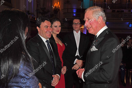 Prince Charles talks with (left to right) violinists Emily Sun and Maxim Vengerov, soprano Louise Alder and conductor John Wilson