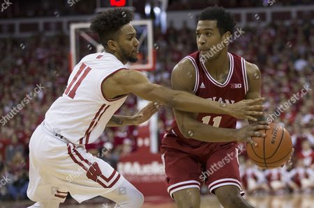 Indiana Hoosiers guard Devonte Green #11 looks to pass while being guarded by Wisconsin Badgers guard Jordan Hill #11 during the NCAA Basketball game between the Wisconsin Badgers and the Indiana Hoosiers at the Kohl Center in Madison, WI. Wisconsin defeated Indiana 65-60