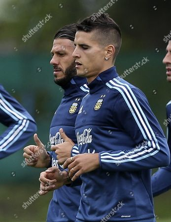 Argentina's Martin Demichelis (l) and Erik Lamela (r) Participates in a Training Session in Ezeiza Province of Buenos Aires Argentina 07 October 2016 Argentina Buenos Aires