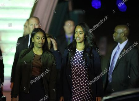 Stock Photo of Daughters of Us President Barack Obama Natasha (l) and Malia (2-r) Disembark From 'Air Force One' Upon Their Arrival at the Ezeiza International Airport Near Buenos Aires Argentina 22 March 2016 the Us President First Lady and Daughters Are Visiting Argentina As the Second and Final Destination of Their Latin American Trip Argentina Buenos Aires