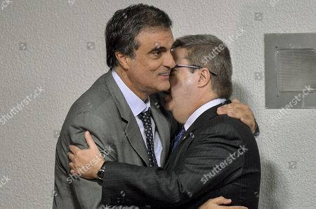 Brazilian Attorney General Jose Eduardo Cardozo (l) Hugs Senator Antonio Anastasia (r) Greets Rapporteur of the Senate Speical Committee Invesitgating the Impeachment Case Against Brazilian President Dilma Rousseff in Brasilia Brazil 05 May 2016 a Supreme Court Justice on 05 May Suspended the Mandate of Eduardo Cunha Brazil's Lower House Speaker and a Key Driving Force Behind Proceedings That Could Lead to an Impeachment Trial Against President Dilma Rousseff Justice Teori Zavascki Based His Ruling on the Numerous Allegations Against Cunha Stemming From a Massive Bribes-for-inflated Contracts Scandal Centered on Brazilian State-controlled Oil Company Petrobras Brazil Brasilia