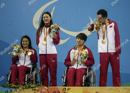 (l-r) Chinese Athletes Peng Qiuping Jiang Shengnan Huang Wenpan and Xu Qing Celebrate with Their Gold Medals After the Paralympic Games Rio 2016 Swimming 4x50 M Free at the Olympic Stadium in Rio De Janeiro Brazil 09 September 2016 Brazil Rio De Janeiro