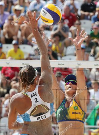 Rippel B Agatha of Brazil (facing) in Action Against Georgina Kluge of Argentina During the Women's Preliminary Round Match Between Agatha/barbara of Brazil and Gally/klug of Argentina of the Rio 2016 Olympic Games at the Beach Volleyball Arena on Copacabana Beach in Rio De Janeiro Brazil 08 August 2016 Brazil Rio De Janeiro