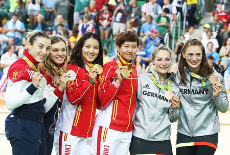 Silver Medalists Daria Shmeleva (l) and Anastasiia Voinova of Russia Gold Medalists Jinjie Gong (center L) and Tianshi Zhong of China and Bronze Medal Winners Kristina Vogel and Miriam Welte (r) During the Medal Ceremony For the Women's Team Sprint Final of the Rio 2016 Olympic Games Track Cycling Events at the Rio Olympic Velodrome in the Olympic Park in Rio De Janeiro Brazil 12 August 2016 Brazil Rio De Janeiro