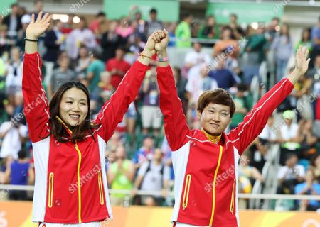 Jinjie Gong (l) and Tianshi Zhong of China Pose with Their Gold Medals After Winning the Women's Team Sprint Final of the Rio 2016 Olympic Games Track Cycling Events at the Rio Olympic Velodrome in the Olympic Park in Rio De Janeiro Brazil 12 August 2016 Brazil Rio De Janeiro