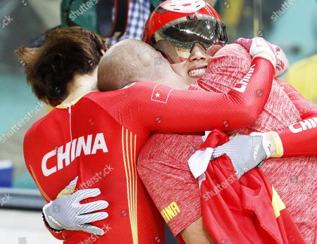 Stock Image of Jinjie Gong (r Facing) and Tianshi Zhong of China Celebrate with Team Member After Winning the Women's Team Sprint Final of the Rio 2016 Olympic Games Track Cycling Events at the Rio Olympic Velodrome in the Olympic Park in Rio De Janeiro Brazil 12 August 2016 Brazil Rio De Janeiro