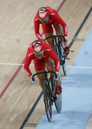 Stock Photo of Jinjie Gong (front) and Tianshi Zhong of China in Action During the Women's Team Sprint Qualification of the Rio 2016 Olympic Games Track Cycling Events at the Rio Olympic Velodrome in the Olympic Park in Rio De Janeiro Brazil 12 August 2016 Brazil Rio De Janeiro