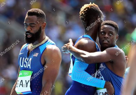 (l-r) Tyson Gay Jarrion Lawson and Christian Coleman of the Usa React After Competing During the Men's 4x100m Relay Heats of the Rio 2016 Olympic Games Athletics Track and Field Events at the Olympic Stadium in Rio De Janeiro Brazil 18 August 2016 Brazil Rio De Janeiro