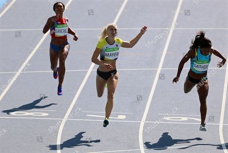 (l-r) Mariely Sanchez of the Dominican Republic Lisa Mayer of Germany and Tynia Gaither of the Bahamas Compete During the Women's 200m Heats of the Rio 2016 Olympic Games Athletics Track and Field Events at the Olympic Stadium in Rio De Janeiro Brazil 15 August 2016 Brazil Rio De Janeiro