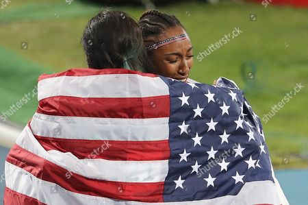 Brianna Rollins of the Us (gold R) and Nia Ali of the Us (silver) Celebrate After the Rio 2016 Olympic Games Women's 100m Hurdles Final at the Olympic Stadium in Rio De Janeiro Brazil 17 August 2016 Brazil Rio De Janeiro