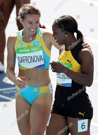 Olga Safronova (l) of Kazakhstan and Veronica Campbell-brown (r) of Jamaica React After Competing During the Women's 200m Heats of the Rio 2016 Olympic Games Athletics Track and Field Events at the Olympic Stadium in Rio De Janeiro Brazil 15 August 2016 Brazil Rio De Janeiro