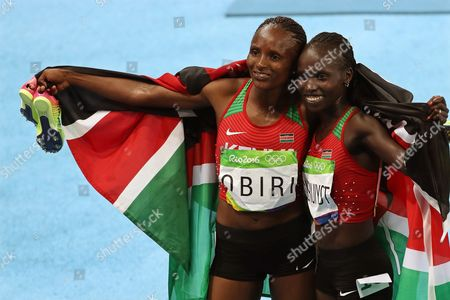 Vivian Jepkemoi Cheruiyot (r) of Kenya Celebrates After Winning the Women's 5000m Final of the Rio 2016 Olympic Games Athletics Track and Field Events at the Olympic Stadium in Rio De Janeiro Brazil 19 August 2016 Cheruiyot Won Ahead of Her Second Placed Compatriot Hellen Onsando Obiri (l) Brazil Rio De Janeiro