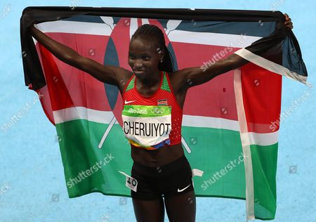 Vivian Jepkemoi Cheruiyot of Kenya Celebrates After Winning the Women's 5000m Final of the Rio 2016 Olympic Games Athletics Track and Field Events at the Olympic Stadium in Rio De Janeiro Brazil 19 August 2016 Brazil Rio De Janeiro