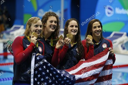 Usa Swimmers Katie Ledecky (l-r) Allison Schmitt (l-r) Leah Smith and Maya Dirado Pose During the Round of Honour After the Medal Ceremony For the Women's 4x200m Freestyle Relay Final Race of the Rio 2016 Olympic Games Swimming Events at Olympic Aquatics Stadium at the Olympic Park in Rio De Janeiro Brazil 10 August 2016 Brazil Rio De Janeiro