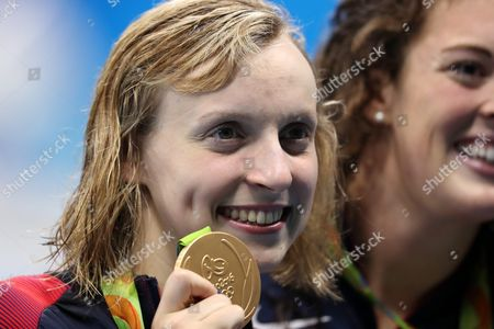 Usa Swimmers Katie Ledecky (l) and Allison Schmitt (r) Pose During the Round of Honour After the Medal Ceremony For the Women's 4x200m Freestyle Relay Final Race of the Rio 2016 Olympic Games Swimming Events at Olympic Aquatics Stadium at the Olympic Park in Rio De Janeiro Brazil 10 August 2016 Brazil Rio De Janeiro