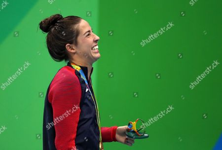 Gold Medalist Maya Dirado of Usa Smiles During the Round of Honour After the Medal Ceremony For Women's 200m Backstroke Final Race of the Rio 2016 Olympic Games Swimming Events at Olympic Aquatics Stadium at the Olympic Park in Rio De Janeiro Brazil 12 August 2016 Brazil Rio De Janeiro
