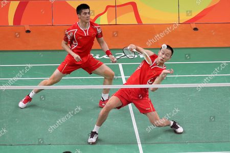 Nan Zhang (r) and Haifeng Fu (l) From China in Action Against Great Britain During Their Men's Doubles Semi-final Match of the Rio 2016 Olympic Games Badminton Events at the Riocentro in Rio De Janeiro Brazil 16 August 2016 Brazil Rio De Janeiro