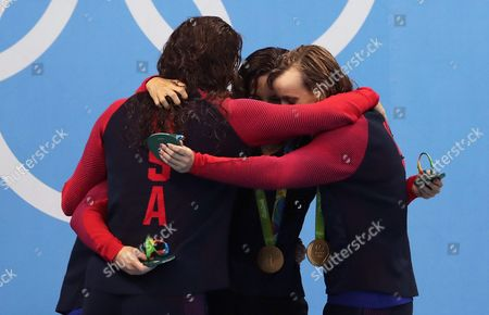 Usa Swimmers Allison Schmitt (l-r) Leah Smith Maya Dirado and Katie Ledecky Hug Each Other During the Medal Ceremony For the the Women's 4x200m Freestyle Relay Final Race of the Rio 2016 Olympic Games Swimming Events at Olympic Aquatics Stadium at the Olympic Park in Rio De Janeiro Brazil 10 August 2016 Brazil Rio De Janeiro