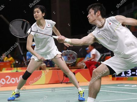 Kenta Kzuno (l) and Ayae Kurihara (r) of Japan in Action During Their Mixed Double Quarterfinals Match of the Rio 2016 Olympic Games Badminton Events Against Nan Zhang and Zhao Yunial of China at the Riocentro in Rio De Janeiro Brazil 14 August 2016 Brazil Rio De Janeiro