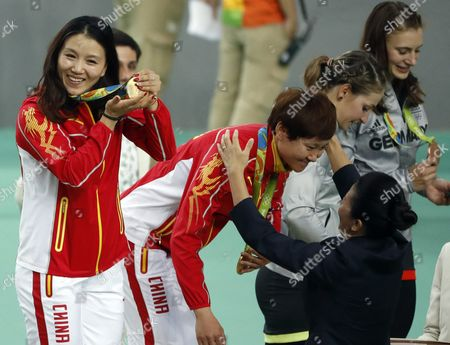 Jinjie Gong (l) and Tianshi Zhong of China Receive Their Gold Medals After Winning the Women's Team Sprint Final of the Rio 2016 Olympic Games Track Cycling Events at the Rio Olympic Velodrome in the Olympic Park in Rio De Janeiro Brazil 12 August 2016 Brazil Rio De Janeiro
