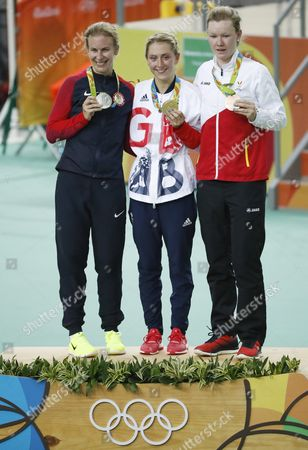 Gold Medalist Laura Trott of Britain is Flanked by Silver Medalist Sarah Hammer (l) of the Usa and Bronze Winner Jolien D'hoore During the Medal Ceremony For the Women's Omnium of the Rio 2016 Olympic Games Track Cycling Events at the Rio Olympic Velodrome in the Olympic Park in Rio De Janeiro Brazil 16 August 2016 Brazil Rio De Janeiro