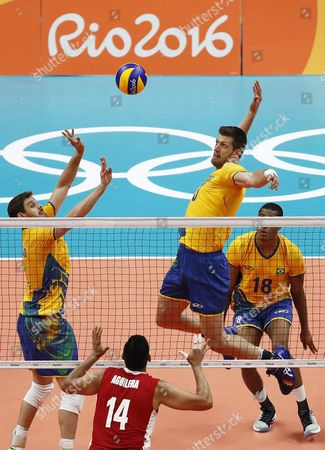 Eder Carbonera of Brazil (2-r) Spikes the Ball During the Men's Volleyball Premliminary Round Pool a Match of the Rio 2016 Olympic Games at Maracanazinho Indoor Arena in Rio De Janeiro Brazil 06 August 2016 Brazil Rio De Janeiro