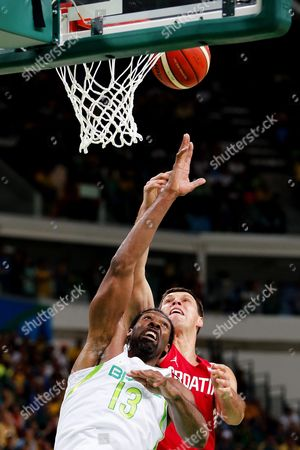 Darko Planinic (r) of Croatia in Action Against Nene Hilario (l) of Brazil During the Men's Basketball Preliminary Round Game Between Brazil and Croatia at the Rio 2016 Olympic Games at the Carioca Arena 1 in the Olympic Park in Rio De Janeiro Brazil 11 August 2016 Brazil Rio De Janeiro