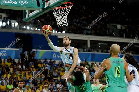 Carlos Delfino (up) of Argentina Goes For a Basket Against Nene Hilario (down) of Brazil During Their Men's Basketball Match of the Rio 2016 Olympic Games at the Carioca Arena 1 in the Olympic Park in Rio De Janeiro Brazil 13 August 2016 Brazil Rio De Janeiro