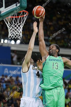 Brazil's Nene Hilario (r) and Argentina's Luis Scola in Action During the Men's Basketball Match Between Argentina and Brazil of the Rio 2016 Olympic Games at the Carioca Arena 1 in the Olympic Park in Rio De Janeiro Brazil 13 August 2016 Brazil Rio De Janeiro