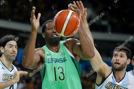 Brazil's Nene Hilario (c) and Patricio Garino (r) of Argentina During the Men's Basketball Match Between Argentina and Brazil of the Rio 2016 Olympic Games at the Carioca Arena 1 in the Olympic Park in Rio De Janeiro Brazil 13 August 2016 Brazil Rio De Janeiro