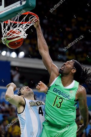 Brazil's Nene Hilario (r) Dunks the Ball the Men's Basketball Match Between Argentina and Brazil of the Rio 2016 Olympic Games at the Carioca Arena 1 in the Olympic Park in Rio De Janeiro Brazil 13 August 2016 Brazil Rio De Janeiro