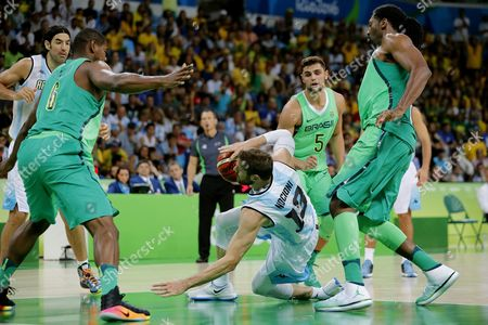 Nicolas Brussino (c) of Argentina Inaction with Brazilian Nene Hilario (r) and Felicio Cristiano (l) During the Men's Basketball Match Between Argentina and Brazil of the Rio 2016 Olympic Games at the Carioca Arena 1 in the Olympic Park in Rio De Janeiro Brazil 13 August 2016 Brazil Rio De Janeiro