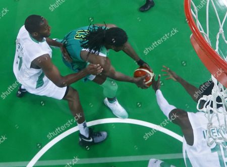 Andy Ogide of Nigeria (l) Nene Hilario of Brazil (c) and Ekene Ibekwe of Nigeria (r) Compete For the Ball During the Men's Preliminary Round Group B Basketball Game Between Nigeria and Brazil of the Rio 2016 Olympic Games at the Carioca Arena 1 in the Olympic Park in Rio De Janeiro Brazil 15 August 2016 Brazil Rio De Janeiro
