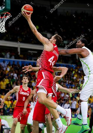 Bojan Bogdanovic (l) of Croatia in Action Against Nene Hilario (r) of Brazil During the Men's Basketball Preliminary Round Game Between Brazil and Croatia at the Rio 2016 Olympic Games at the Carioca Arena 1 in the Olympic Park in Rio De Janeiro Brazil 11 August 2016 Brazil Rio De Janeiro