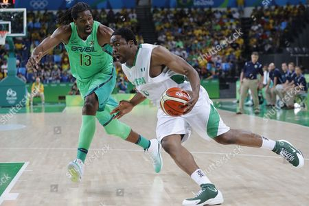 Ike Diogu of Nigeria (r) and Nene Hilario of Brazil (l) Compete For Possession During the Men's Preliminary Round Group B Basketball Game Between Nigeria and Brazil of the Rio 2016 Olympic Games at the Carioca Arena 1 in the Olympic Park in Rio De Janeiro Brazil 15 August 2016 Brazil Rio De Janeiro
