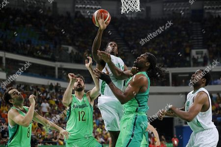 (l-r) Vitor Benite of Brazil Guilherme Giovannoni of Brazil Alade Aminu of Nigeria Nene Hilario of Brazil and Ike Diogu of Nigeria Compete For Possession During the Men's Preliminary Round Group B Basketball Game Between Nigeria and Brazil of the Rio 2016 Olympic Games at the Carioca Arena 1 in the Olympic Park in Rio De Janeiro Brazil 15 August 2016 Brazil Rio De Janeiro