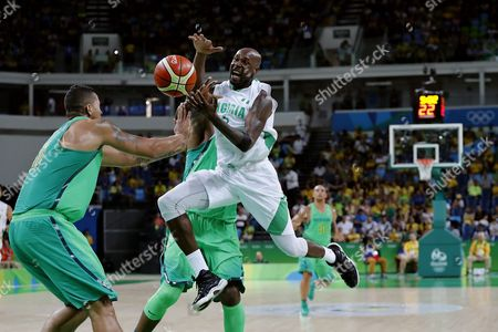 Ere Ebi of Nigeria (r) Rafael Hettsheimeir of Brazil (2-l) and Nene Hilario of Brazil (l) During the Men's Preliminary Round Group B Basketball Game Between Nigeria and Brazil of the Rio 2016 Olympic Games at the Carioca Arena 1 in the Olympic Park in Rio De Janeiro Brazil 15 August 2016 Brazil Rio De Janeiro