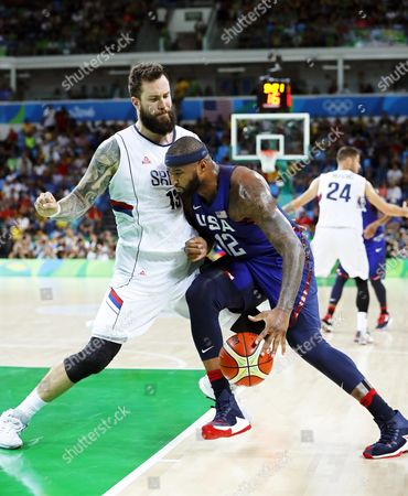 Demarcus Cousins (r) of the Usa in Action Against Miroslav Raduljica (l) of Serbia During the Men's Basketball Gold Medal Game Between Serbia and the Usa at the Rio 2016 Olympic Games at the Carioca Arena 1 in the Olympic Park in Rio De Janeiro Brazil 21 August 2016 Brazil Rio De Janeiro