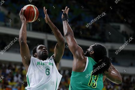 Stock Photo of Ike Diogu of Nigeria (l) and Nene Hilario of Brazil (r) Compete For Possession During the Men's Preliminary Round Group B Basketball Game Between Nigeria and Brazil of the Rio 2016 Olympic Games at the Carioca Arena 1 in the Olympic Park in Rio De Janeiro Brazil 15 August 2016 Brazil Rio De Janeiro