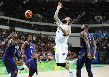 Demarcus Cousins (r) of the Usa in Action Against Miroslav Raduljica (c) of Serbia During the Men's Basketball Gold Medal Game Between Serbia and the Usa at the Rio 2016 Olympic Games at the Carioca Arena 1 in the Olympic Park in Rio De Janeiro Brazil 21 August 2016 Brazil Rio De Janeiro