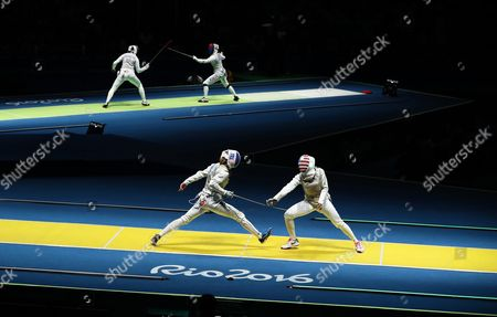 Astrid Guyart (l) of France in Action Against Nzingha Prescod (r) of the Usa During the Women's Foil Individual Round of 16 of the Rio 2016 Olympic Games Fencing Events at the Carioca Arena 3 in the Olympic Park in Rio De Janeiro Brazil 10 August 2016 Brazil Rio De Janeiro