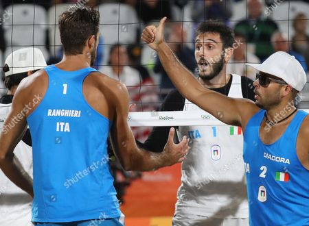 Alex Ranghieri (l) of Italy Compatriot Paolo Nicolai (c) During the Men's Beach Volleyball Match Between Ranghieri/carambula of Italy and Nicolai/lupo of Italy For the Rio 2016 Olympic Games Beach Volleyball Tournament on Copacabana Beach in Rio De Janeiro Brazil 12 August 2016 Brazil Rio De Janeiro